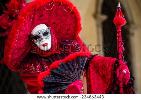 VENICE, FEBRUARY 10: An unidentified couple in typical dress poses during traditional Venice Carnival on February 10, 2013 in Venice - stock photo