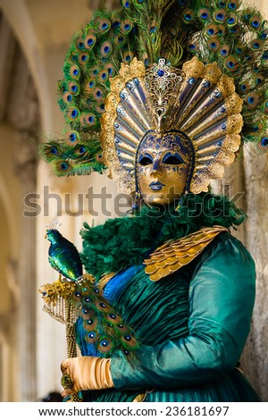 VENICE, FEBRUARY 10: An unidentified woman in typical dress in green and gold colors poses during traditional Venice Carnival on February 10, 2013 in Venice - stock photo