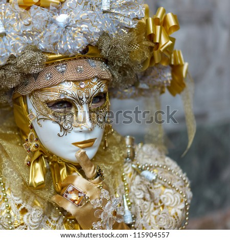 VENICE - FEBRUARY 21: Person in Venetian costume attends the Carnival of Venice, festival starting two weeks before Ash Wednesday on February 21, 2011 in Venice, Italy. - stock photo