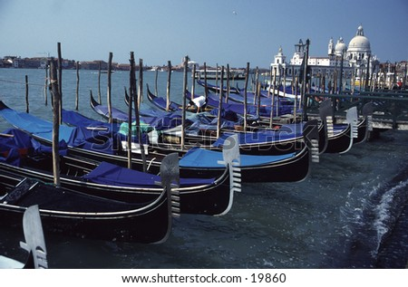 Venice Gondolas at Shores of Grand Canal - stock photo