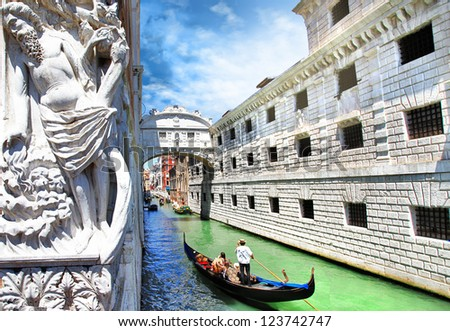 Venice --gondolas passing over Bridge of Sighs - stock photo