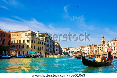 Venice Grand canal with gondolas and Rialto Bridge, Italy in summer bright day - stock photo