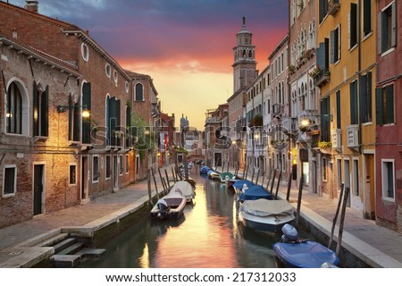 Venice. Image of one of many narrow canals in Venice during beautiful sunset. - stock photo