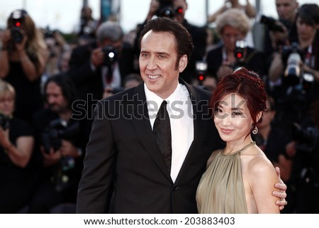 VENICE, ITALY - AUGUST 30: Actor Nicolas Cage and his wife Alice Kim attend 'Joe' Premiere during The 70th Venice  Film Festival on August 30, 2013 in Venice, Italy - stock photo