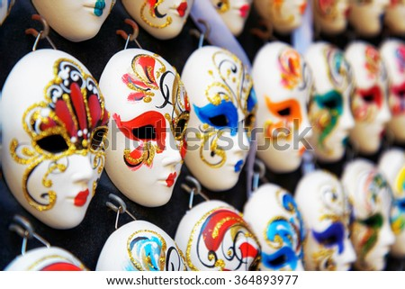 VENICE, ITALY - AUGUST 24, 2014: Authentic and original Venetian full-face masks for Carnival in street shop of Venice, Italy. Handmade masks with ornate design and bright colors. - stock photo