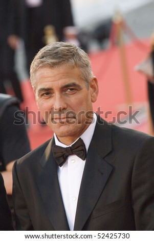 VENICE, ITALY - AUGUST 27: George Clooney greets fans as he arrives at the opening ceremony and 'Burn After Reading' Premiere during the 65th Venice Film Festival on August 27, 2008 in Venice, Italy - stock photo