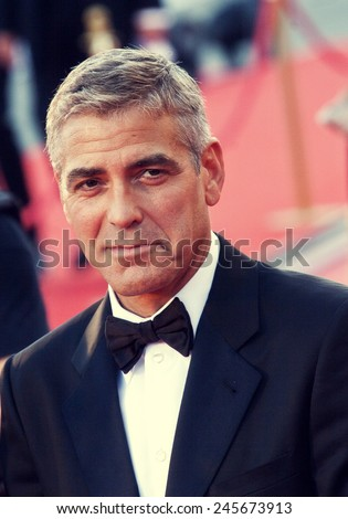 VENICE, ITALY - AUGUST 27: George Clooney greets fans as the arrives at the opening ceremony and  'Burn After Reading' Premiere during the 65th Venice Film Festival on August 27, 2008 in Venice, Italy - stock photo