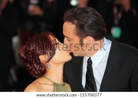 VENICE, ITALY - AUGUST 30: Nicolas Cage and his wife Alice Kim Cage at the 'Joe' Premiere  during the 70th Venice International Film Festival on August 30, 2013 in Venice, Italy  - stock photo