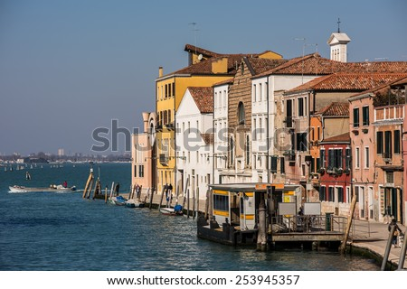 Venice, Italy - Buildings and boats in the canal in the Sestiere Cannaregio - stock photo
