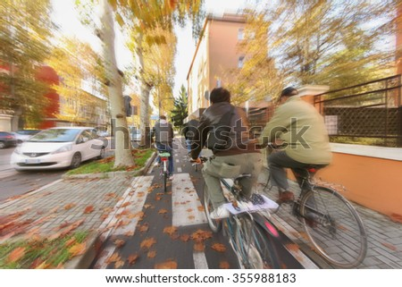 venice, ITALY december 2012 small group of friends cycling  around the street at morning light - stock photo