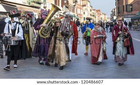 VENICE,ITALY-FEB. 26: Funny orchestra marching and singing in the streets on February 26, 2011 in Venice, Italy. In 2011 the Venice Carnival was held between 11- 21 February. - stock photo