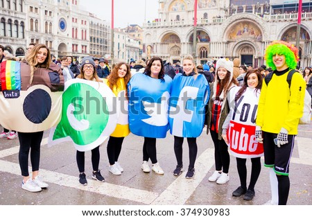 VENICE, ITALY - FEBRUARY 9, 2016: Carnival of Venice. People showing beautiful, colorful and funny masks in Piazza San Marco for the famous event. - stock photo