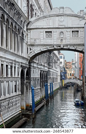 VENICE, ITALY-FEBRUARY 14, 2007: the Bridge of Sighs and tourists in the bottom. Venice is a great tourists attraction with more than 27 million tourists every year. - stock photo