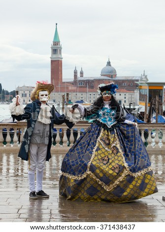Venice, Italy - February 01, 2015: The city in celebration during the famous carnival. Masks have always been an important feature of the Venetian carnival.  - stock photo