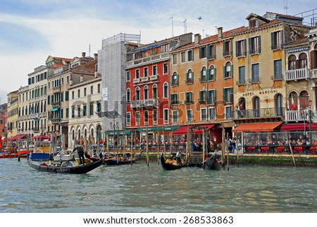 VENICE, ITALY-FEBRUARY 14, 2007: tourists along the Grand canal at sunset. Venice is a great tourists attraction with more than 27 million tourists every year. - stock photo