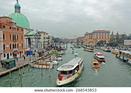 VENICE, ITALY-FEBRUARY 20, 2007: tourists and city life in the grand canal in Cannaregio area. Venice is a great tourists attraction with more than 27 million tourists every year.  - stock photo