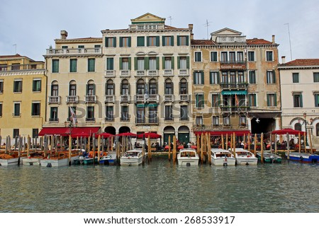 VENICE, ITALY-FEBRUARY 14, 2007: tourists relaxing along the Grand canal at sunset. Venice is a great tourists attraction with more than 27 million tourists every year. - stock photo