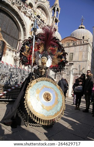 VENICE, ITALY - FEBRUARY 8, 2015: Unidentified masked man in warrior costume on San Marco Square during the Carnival in Venice, Italy. - stock photo