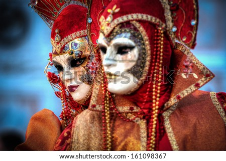 VENICE, ITALY - FEBRUARY 8: Unidentified people in Venetian masks at St. Mark's Square, Carnival of Venice on February 8, 2013. The annual carnival is from February 2 to February 12, 2013. - stock photo