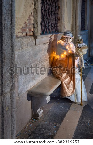 VENICE, ITALY - FEBRUARY 7, 2016:  White Dressed Mask Figure in Venice, Italy. The Venice Carnival ends with the Christian celebration of Lent, forty days before Easter - stock photo