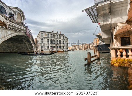 Venice, Italy. Fisheye view of Rialto Bridge on a cloudy day. - stock photo