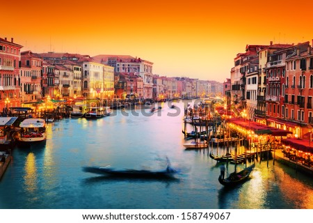 Venice, Italy. Gondola floats on Grand Canal, Italian Canal Grande at sunset. View from Rialto Bridge - stock photo