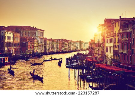 Venice, Italy. Gondolas on Grand Canal, Italian Canal Grande at gold sunset. View from Rialto Bridge. Vintage, retro style - stock photo