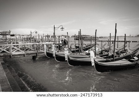 Venice, Italy gondolas - typical local passenger transportation boats. Black and white tone - retro monochrome color style. - stock photo