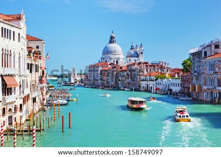 Venice, Italy. Grand Canal and Basilica Santa Maria della Salute at sunny day. View from Ponte dell Accademia - stock photo