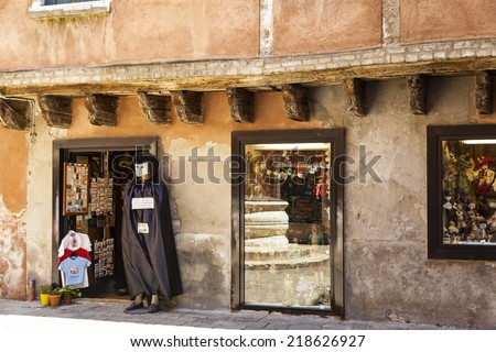 VENICE, ITALY - JUN 1, 2014: Souvenirs shop  like this offer all kind of present and souvenirs to tourist in all section of town. This is a major income source for the local population. - stock photo
