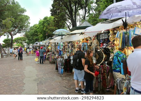 VENICE,ITALY ,JUNE 25, 2015: Outside vendors selling goods to tourists in Venice Italy on June 25, 2015 - stock photo