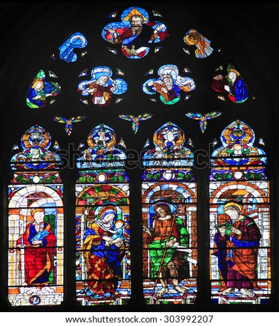 VENICE, ITALY - JUNE 13, 2015. The largest stained glass window in all Venice crafted by 15th century Murano glass artists in Venice, crafted by 15th century Murano glass artists, San Zanipolo Church  - stock photo