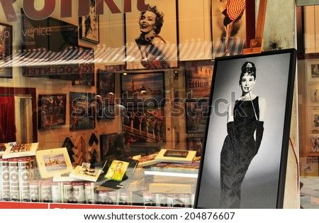 VENICE, ITALY - MAY 6, 2012: Celebrities pictures for sale in vintage print shop in Rialto, major touristic and commercial area in Venice - stock photo