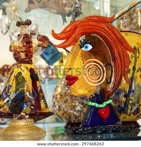 VENICE, ITALY - MAY 29, 2015: Murano glass artworks on display in shop in island of Murano, Venice.  - stock photo