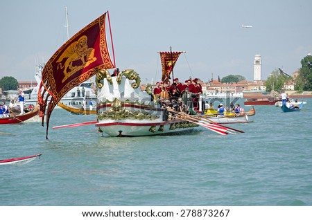 VENICE, ITALY - MAY 17, 2015:  Ornate boat carrying musicians and VIPs being rowed across the Lagoon from St Marks to Lido as part of the Marriage of the Sea ceremony to mark Ascension Day in Venice. - stock photo
