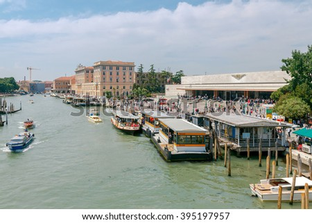Venice, Italy - 25 May, 2015: The Central railway station of Santa Lucia and the pier for the vaporetto on the Grand Canal. Water transport is the most popular means of transportation in the city. - stock photo