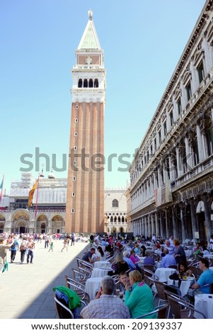 VENICE, ITALY - MAY 9, 2014: The famous San Marco square and clock tower in Venice, Italy. - stock photo