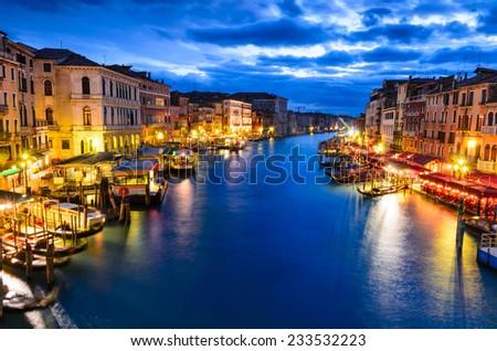 Venice, Italy. Night view of  Grand Canal, seen from Rialto Bridge, touristic place of Venice laguna. - stock photo