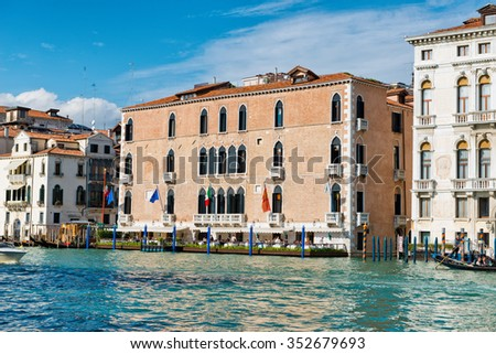 VENICE, ITALY - 17 OCTOBER 2015: Exterior of the Gritti Palace Hotel, Venice with its outdoor restaurant terrace overlooking the Grand Canal viewed from the water. Venice, Italy on 17 October 2015. - stock photo