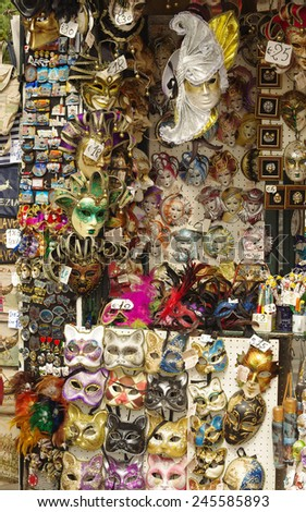 VENICE, ITALY - OCTOBER 8, 2011: Vendor stands - profitable and popular form of sales of traditional souvenirs such as the traditional venetian masks. Photo taken at Gran Canal Venice on oct. 8, 2011  - stock photo