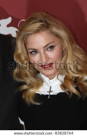 VENICE, ITALY - SEPTEMBER 01: Madonna arrives at the 'W.E.' photocall at the Palazzo Del Cinema during the 68th Venice Film Festival on September 1, 2011 in Venice, Italy. - stock photo