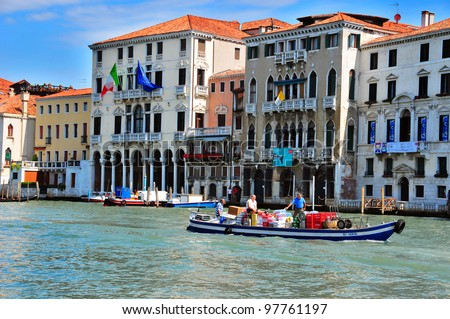 VENICE - JUNE 12: Tansportation of food by boat on the Grand canal on June 11, 2011 in Venice, Italy. More than 20 million tourists come to Venice annually. - stock photo