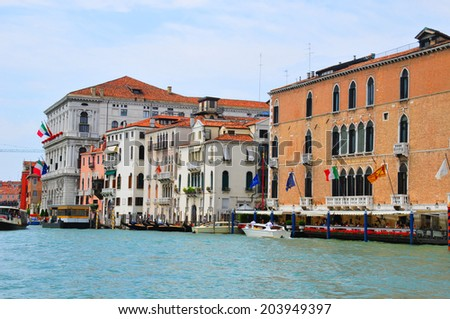 VENICE - JUNE 12: The Grand canal on June 12, 2011 in Venice, Italy. Venice is a city in northeast Italy sited on a group of 118 small islands. More than 20 million tourists come to Venice annually. - stock photo