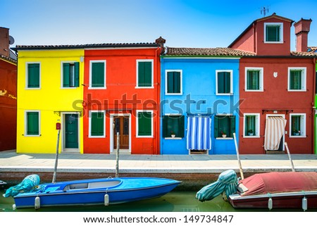 Venice landmark, Burano island canal, colorful houses and boats, Italy. Long exposure photography - stock photo