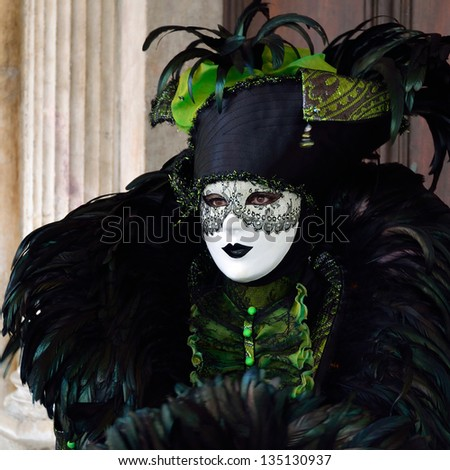 VENICE - MARCH 6: A participant in  costume in St. Mark's Square during the Carnival of Venice on March 6, 2011. The 2011 carnival is held from February 26th to March 8th - stock photo