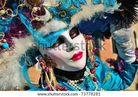 VENICE - MARCH 7: An unidentified masked person in costume on the street during the Carnival of Venice on March 7, 2011. The 2011 carnival was held from February 26th to March 8th. - stock photo