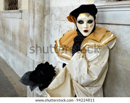 VENICE - MARCH 5, 2011: Person in Venetian costume attends the Carnival of Venice, festival starting two weeks before Ash Wednesday and ends on Shrove Tuesday, on March 5, 2011 in Venice, Italy. - stock photo