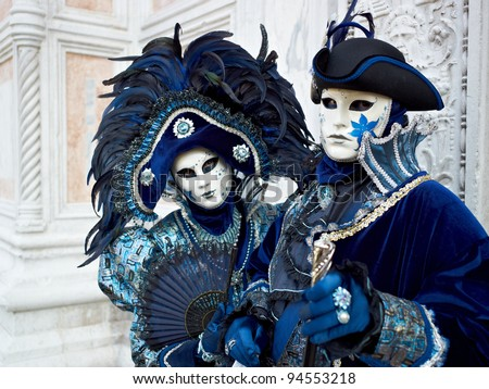 VENICE - MARCH 5, 2011: Persons in Venetian costume attend the Carnival of Venice, festival starting two weeks before Ash Wednesday and ends on Shrove Tuesday, on March 5, 2011 in Venice, Italy. - stock photo