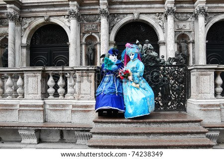 VENICE - MARCH 7: Two unidentified masked persons in  Venice on March 7, 2011. The 2011 carnival was held from February 26th to March 8th. - stock photo