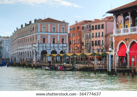 VENICE - NOVEMBER 22: Rialto market on a sunny day on November 22, 2015 in Venice. It's an area of the San Polo sestiere, also known for its markets and for the Rialto Bridge across the Grand Canal. - stock photo